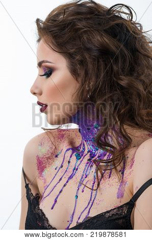 Portrait of beautiful sexy woman model with professional makeup and bodyart paint with jewelery and precious stones solated on white background.