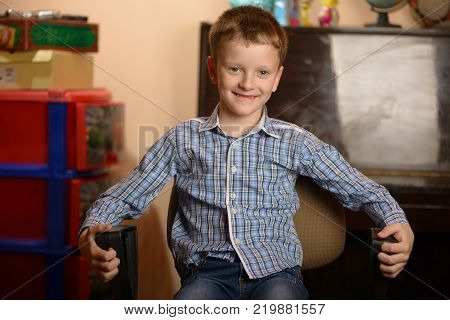 Young man in an office chair. Different facial expressions and emotional moods. poster