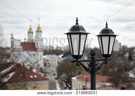 Old Lantern With the Holy Resurrection Church on Background