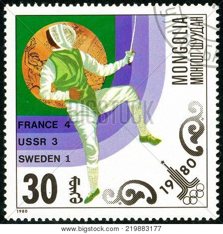 Ukraine - circa 2017: A postage stamp printed in Mongolia shows drawing Fencing. Series: Olympic gold medalists in 1980 Moscow. Circa 1980.