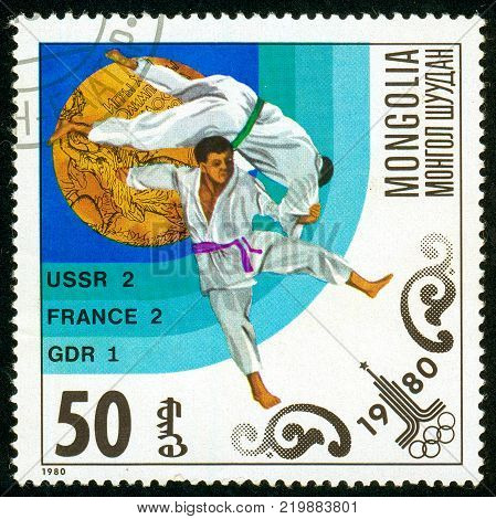 Ukraine - circa 2017: A postage stamp printed in Mongolia shows drawing Judo. Series: Olympic gold medalists in 1980 Moscow. Circa 1980.