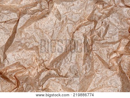 Abstract background of old wrinkled paper handmade tender orange color.