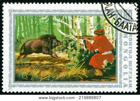 Ukraine - circa 2017: A postage stamp printed in Mongolia shows drawing Wild Boar Sus scrofa Hunting. Series: Hunting in Mongolia. Circa 1975.