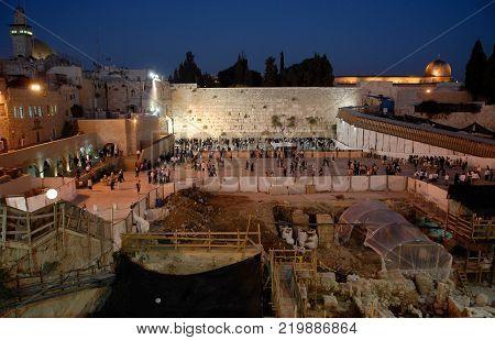 Wailing Wall in Jerusalem, twilight lighting street lights, Old City, Jewish Quarter, Israel.
