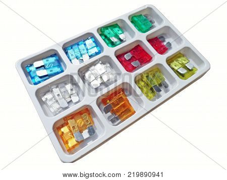Box of colorful fuses for auto on white background