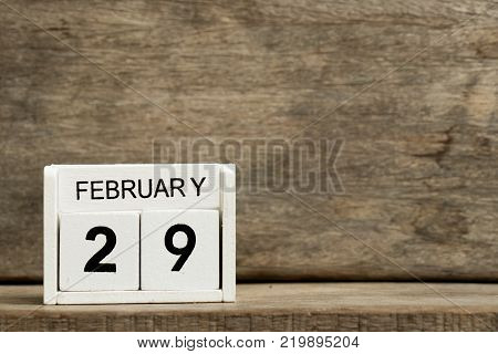 White block calendar present date 29 and month February on wood background (leap day)
