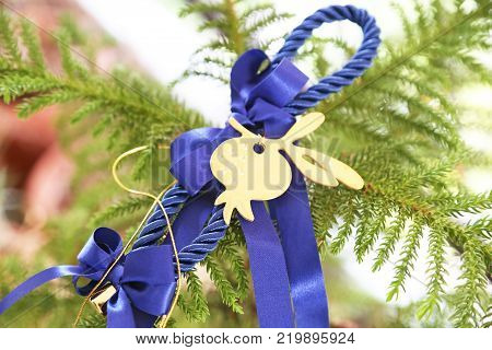 decorative Christmas lucky charm with blue ribbons and lucky pomegranate