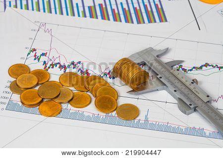 Miniature Business Man And Vernier Measuring Money Coin