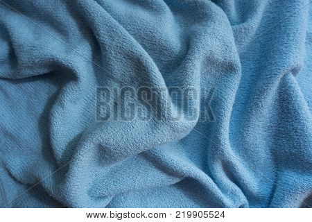 Draped sky blue fabric without prints or patterns