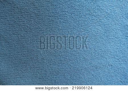 Surface of simple sky blue fabric from above