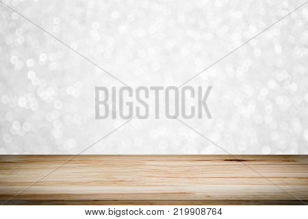 empty wooden on white lighting backdrop. christmas light background. Wood table top. can used for display or montage your products