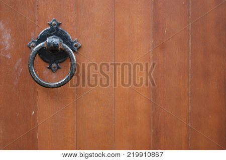 Old fashioned door handle on a wooden church door.