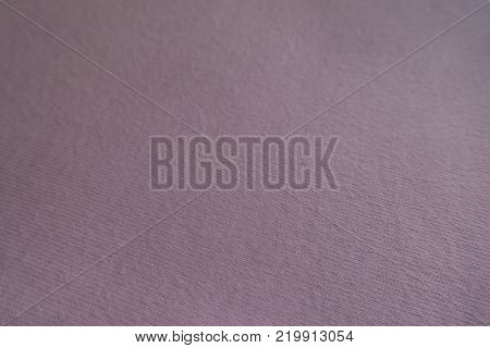 Close view of simple light pink fabric