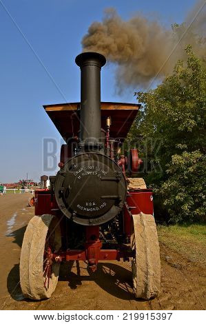 ROLLAG, MINNESOTA, Sept 2, 2017: A  Gaar Scott steam engine billows black smoke  the annual WCSTR farm show in Rollag held each Labor Day weekend where 1000's attend.