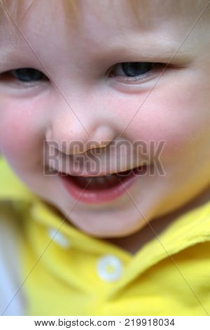 Baby boy smile with blue eyes on happy face and blond hair on natural environment. Child childhood family. Happiness innocence infancy future concept