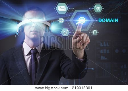 Business Technology Internet and network concept. Young businessman working in virtual reality glasses sees the inscription: Domain