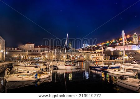 Night scenery in Dubrovnik city harbor, famous european travel resort in Croatia, Southern Europe.