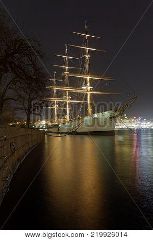 STOCKHOLM SWEDEN - DEC 27 2017: Nightscape of the sailing ship and hotel Af Chapman in central Stockholm in Sweden December 27 2017