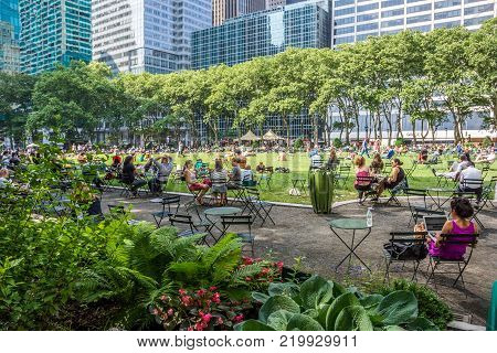 NEW YORK-JUNE 9: Bryant Park in mid-town Manhattan crowded with people woking and relaxing on June 9 2015 in New York City.