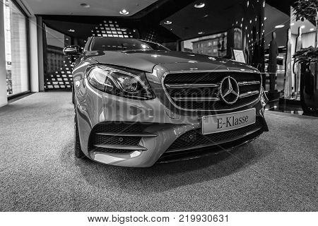 BERLIN - DECEMBER 21, 2017: Showroom. Executive car Mercedes-Benz E-Class E220d (W213). Since 2017. Black and white.