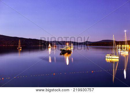 Night shot of luxury yachts moored  against the shore in Slano, Croatia