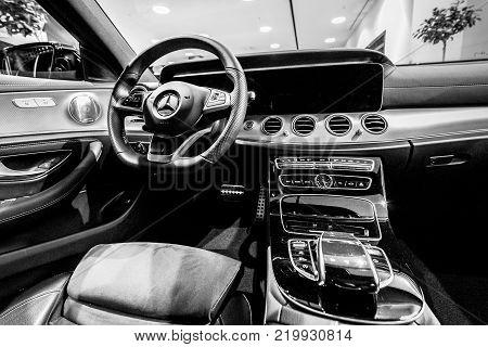 BERLIN - DECEMBER 21, 2017: Showroom. Cabin of the executive car Mercedes-Benz E-Class E220d (W213). Black and white. Since 2017.