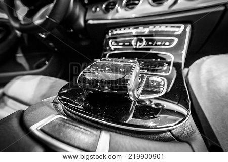 BERLIN - DECEMBER 21, 2017: Showroom. The shift knob of the executive car Mercedes-Benz E-Class E220d (W213). Close-up. Black and white. Since 2017.