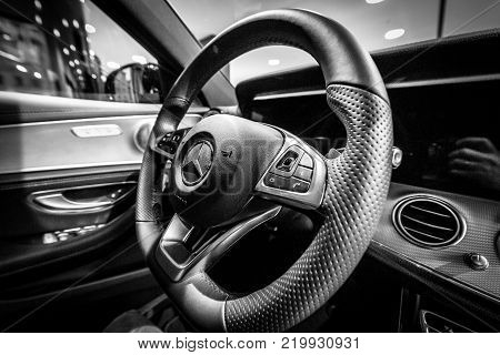 BERLIN - DECEMBER 21, 2017: Showroom. Cabin of the executive car Mercedes-Benz E-Class E220d (W213). Close-up. Black and white. Since 2017.