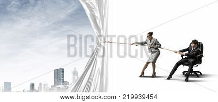 Two businesspeople pulling white blank fabric with rope
