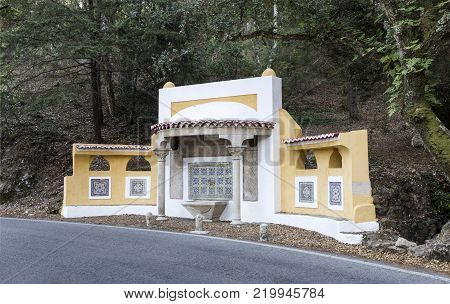 Water fountain of the 19th century located on the road side between Sintra village and Monserrate palace, in Sintra Mountain, Portugal