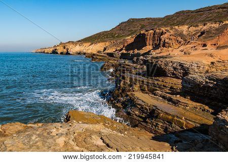 Cliffside erosion and ocean waves at Point Loma tidepools in San Diego, California