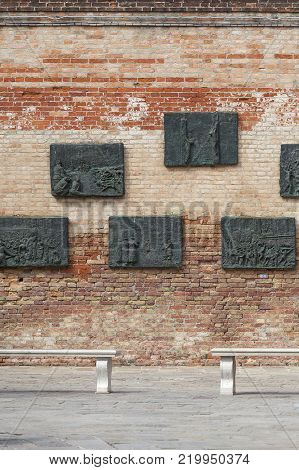 VENICE, ITALY - SEPTEMBER 23, 2017: Venetian Ghetto, wall with carved reliefs on bronze plates, memorial to Venetian Jews. Ghetto was founded in 1516 in the times of the Republic of Venice. It was the first ghetto in the world