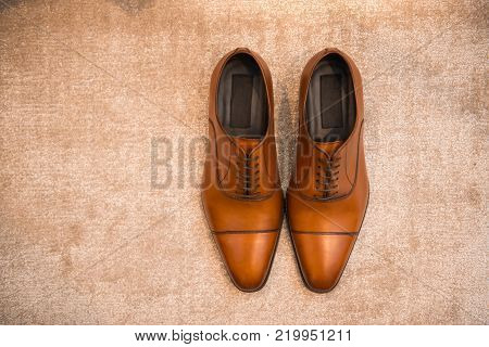 Brown leather classic male shoes on the floor