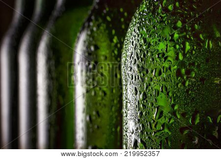 Beer in the bottle. Close-up. Drops of water on a chilled beer bottle. Concept: St. Patrick's Day, Oktoberfest, Bavaria, Germany, Mardi Gras