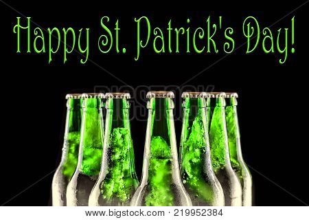 Happy St. Patrick's Day Chilled beer. Brewed beer in bottles on a black background. close up