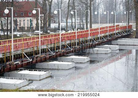 Dobrush, Belarus - December 28, 2017: Pantone Bridge To The Island.