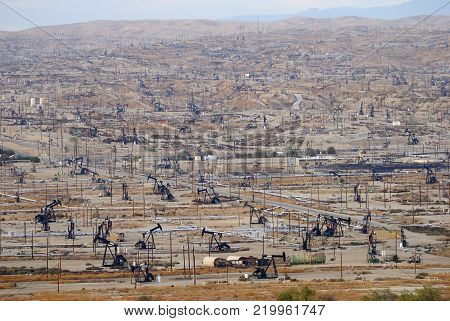 View over oil field in Bakersfiled, California,with derricks pumps.