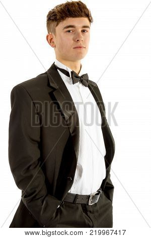 18 year old wearing a tuxedo isolated on a white background