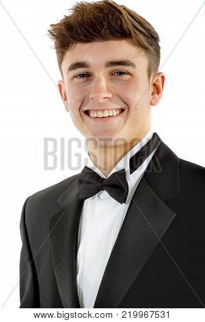 18 year old wearing a tuxedo smiling isolated on a white background