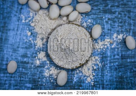 Close Up Of Ayurvedic Herb Kuanch,cowhage,mucuna Pruriens With Powder.
