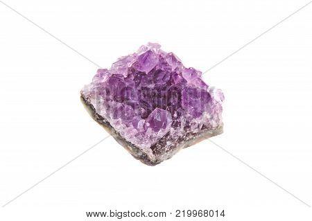 Stone amethyst crystal druse, isolated on white background, macro