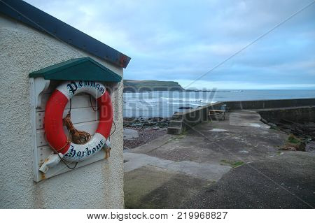 Pennan Harbour Life Ring and View, Scotland