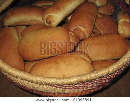 lavish baked poppy buns from yeast dough lying in a large wicker basket