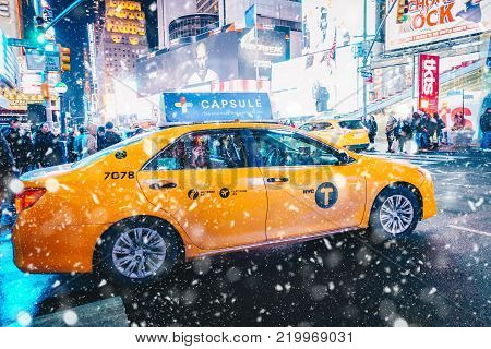 New York City, Usa - March 18, 2017: People In Yellow Cab Shot Famous Led Advertising Panels In Time