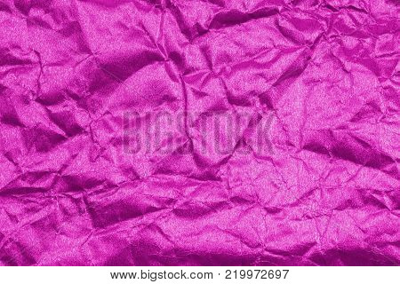Texture crease of pink paper for template wallpaper. wrinkle of paper crumpled background.