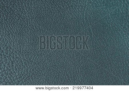 Texture of artificial leather. Gray background or leatherette backdrop.