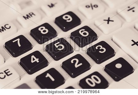 Closeup view of old and dusty calculator plastic buttons.