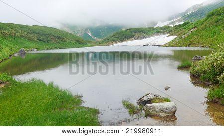 pond on mountaintop , Tateyama Kurobe Alpine , Japan