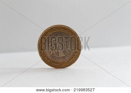 Turkish coin lie on isolated white background Denomination is one lira