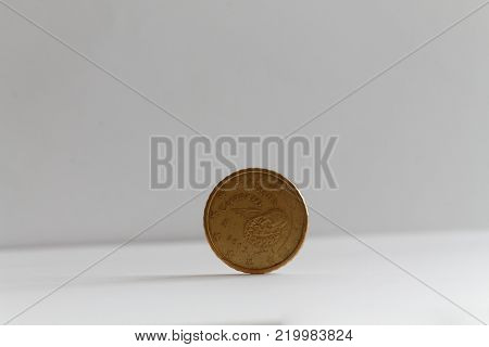 One euro coin on isolated white background Denomination is 10 euro cents - back side